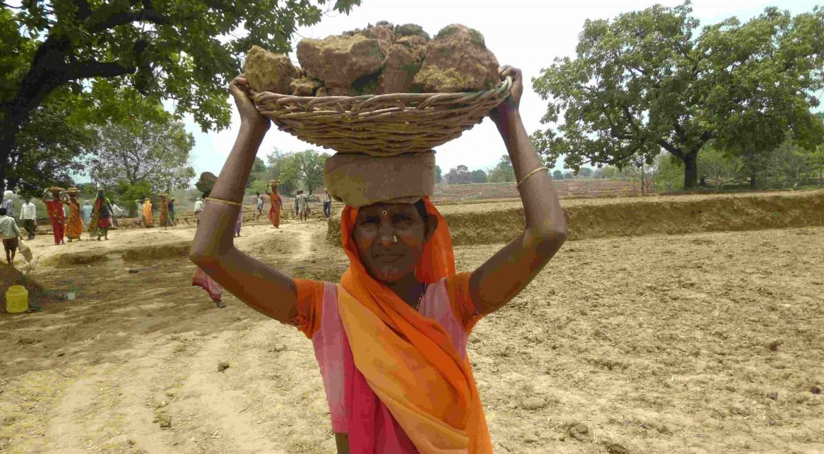 Women doing job through MGNREGA campaigning