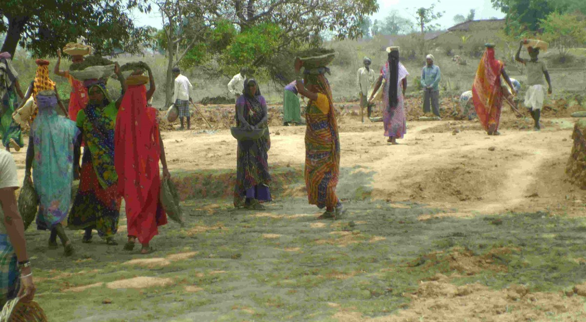 Men and Women doing MGNREGA work in the village